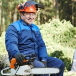 Logger with chainsaw in the forest