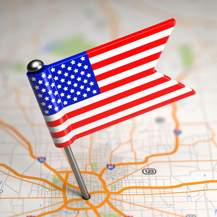United States of America Small Flag on a Map Background.